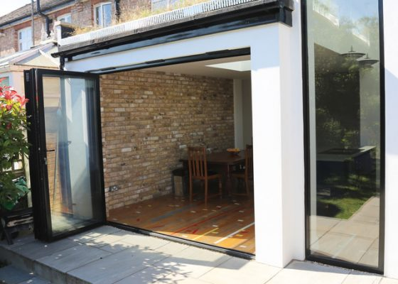 An image of an outside patio area with glass doors